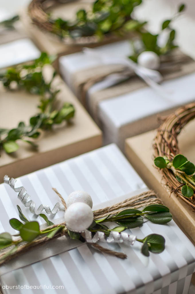 A simple homemade mini boxwood wreath creates a festive gift topper for the holidays.