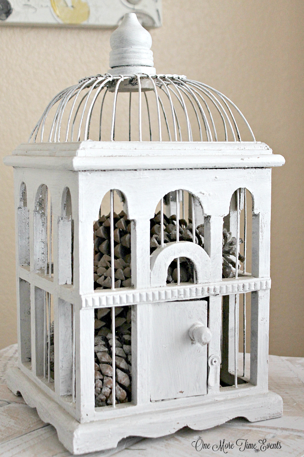 White-Bird-house-filled-with-pinecones-for-a-inexpensive-Winter-setting