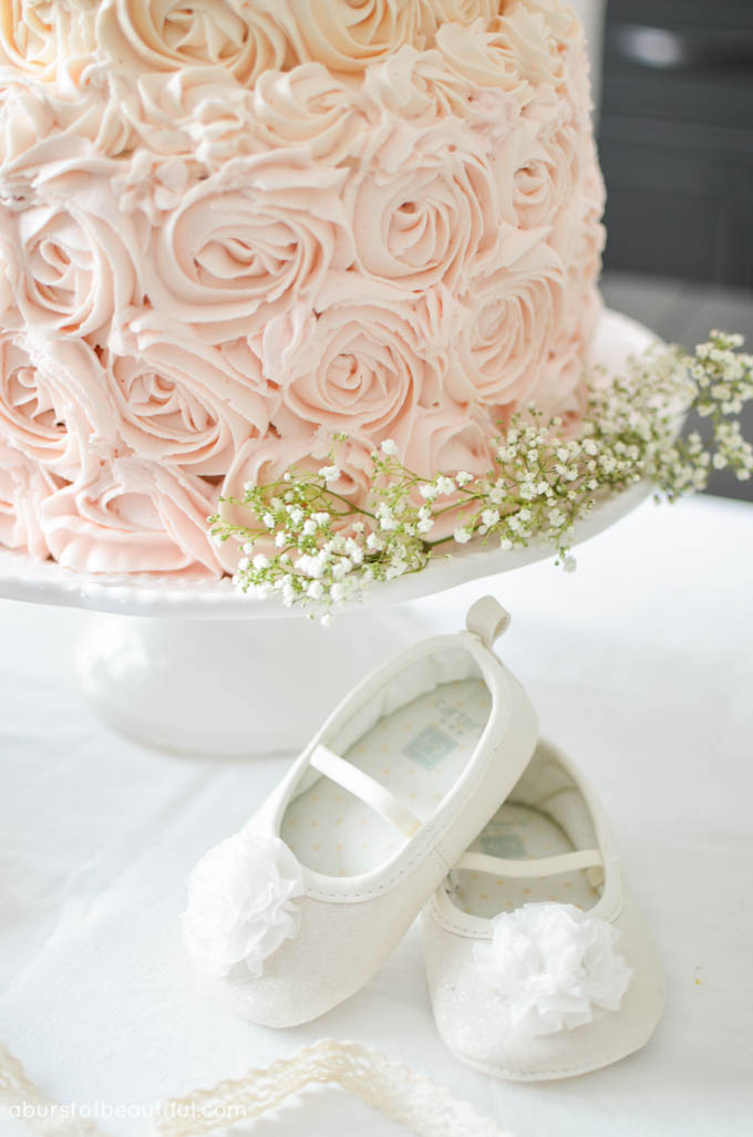 A beautiful pink ombre rosette cake takes centre-stage at a whimsical first birthday party | A Burst of Beautiful