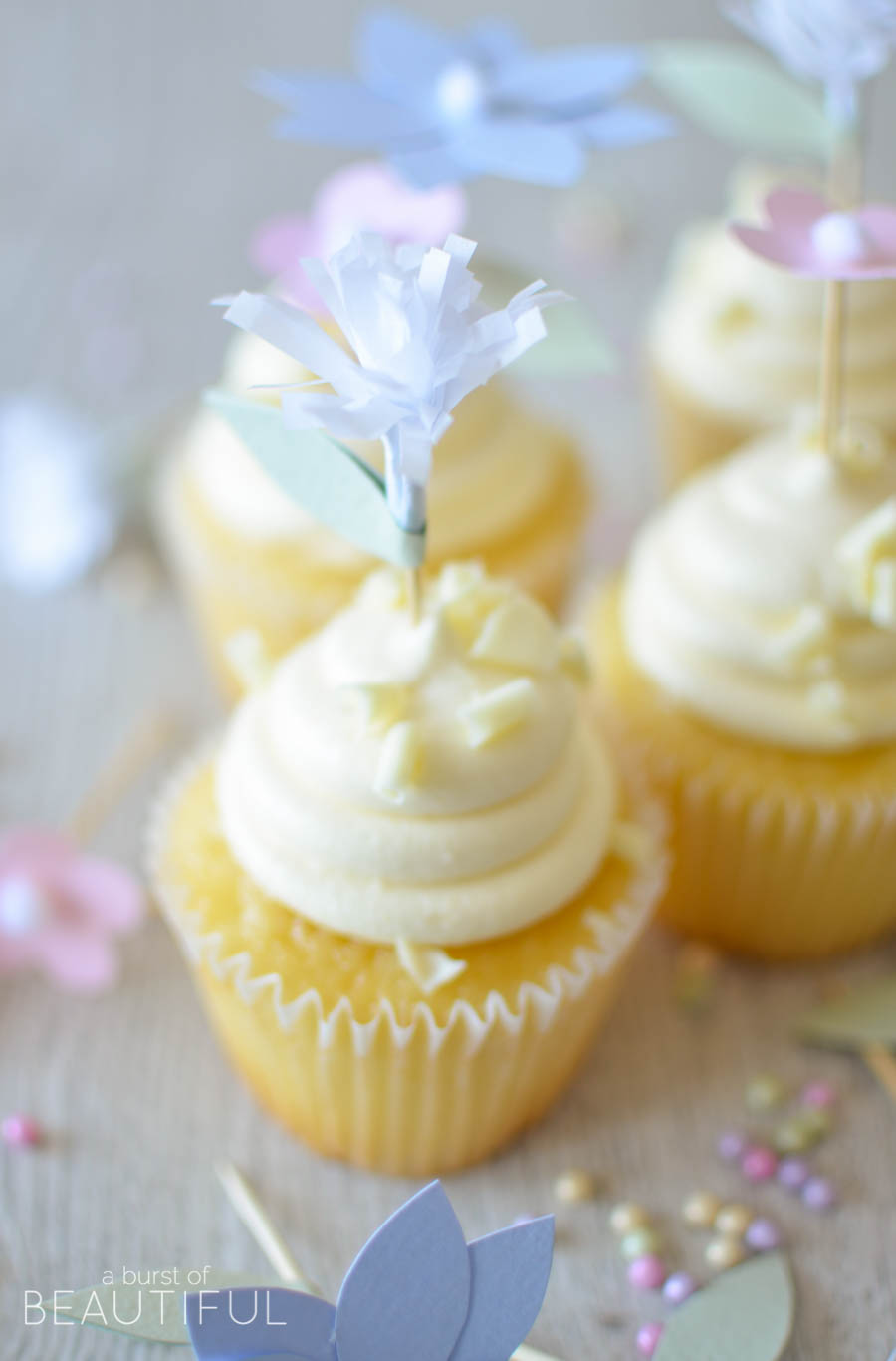 Add a whimsical touch to your next special event with these pretty DIY flower cupcake toppers   A Burst of Beautiful