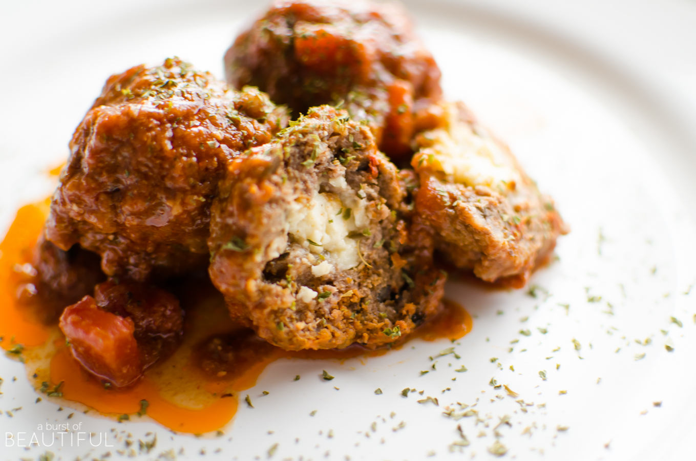 Perfect as an appetizer or served as part of a meal, our Slow Cooker Stuffed Mediterranean Meatballs are stuffed with feta cheese, sundried tomatoes and black olives to create a mouthwatering flavour combination | A Burst of Beautiful
