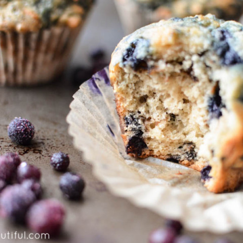 The Best Blueberry Muffins - These fluffy, moist muffins are bursting with fresh blueberries in every bite. Find the recipe at www.aburstofbeautiful.com | A Burst of Beautiful