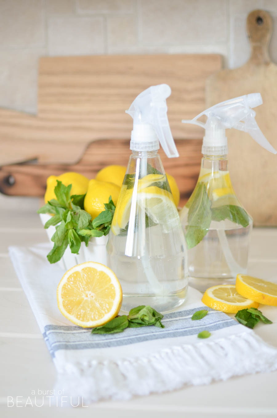 Mint and lemon infused natural homemade all purpose cleaner is an easy and inexpensive way to clean your home naturally | A Burst of Beautiful