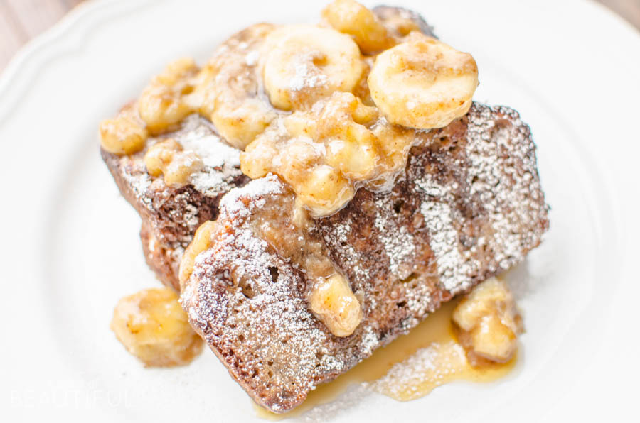 Homemade banana bread and caramelized bananas make this delectable Bananas Foster French Toast the perfect addition to breakfast, brunch or dessert. Find the recipe at www.aburstofbeautiful.com