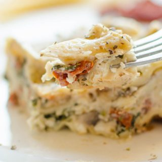 Serve this creamy portobello mushroom and sundried tomato lasagna with a homemade caesar salad and garlic loaf for a hearty and comforting meal.