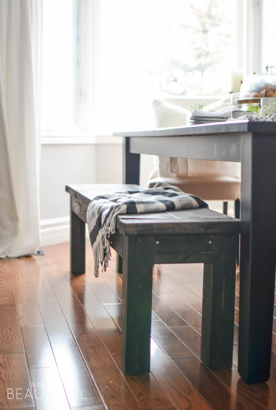 Learn how to build a rustic DIY farmhouse bench with this simple plan | A Burst of Beautiful