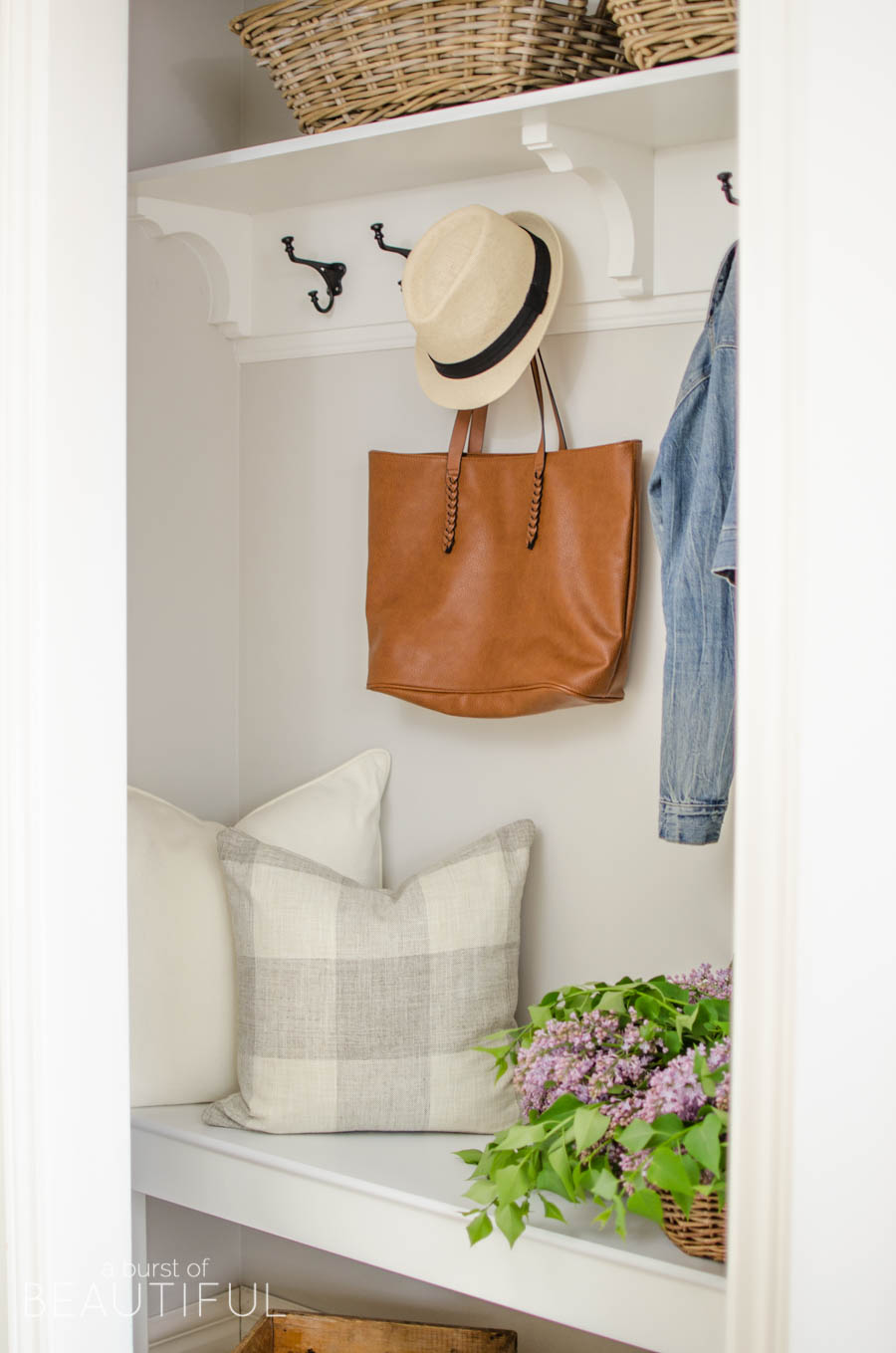 A cramped coat closet turns into a beautiful farmhouse inspired entry for a busy family with this simple makeover | A Burst of Beautiful