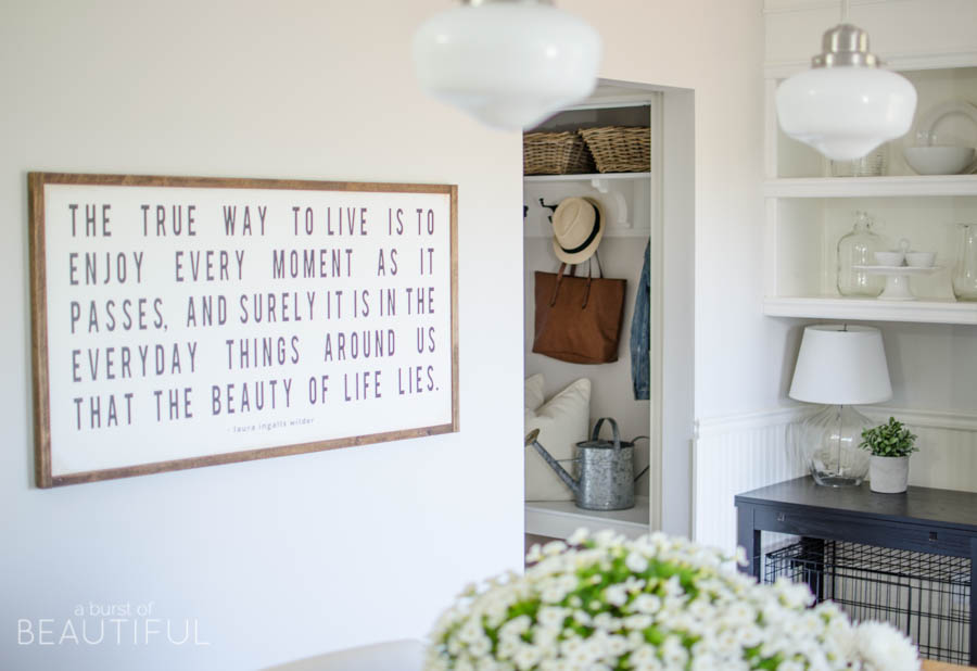 A custom wood sign adds charm and character to this beautiful farmhouse kitchen | A Burst of Beautiful