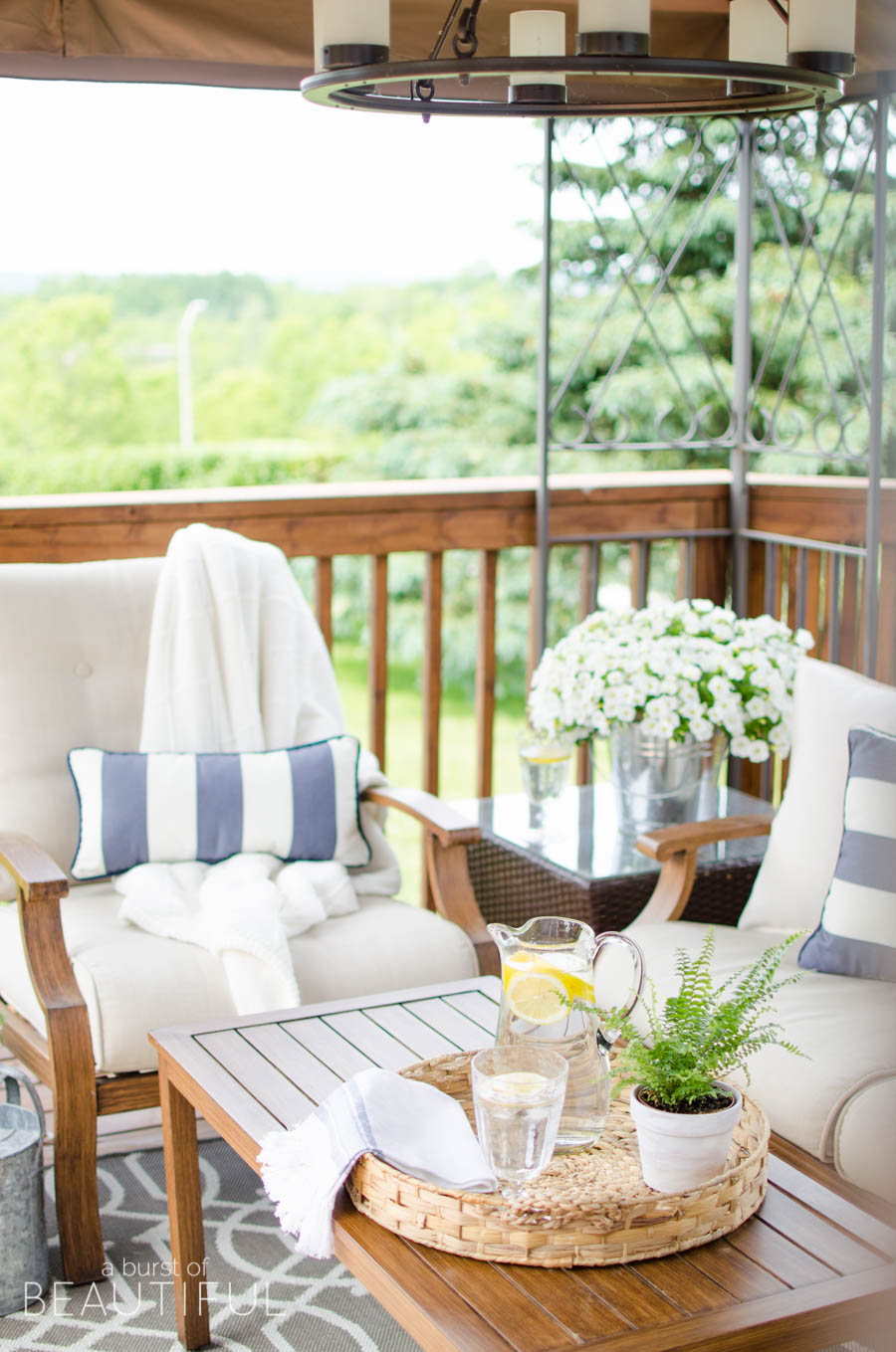 Learn how to revive a wood deck and create a beautiful outdoor living space with these easy to follow instructions from A Burst of Beautiful