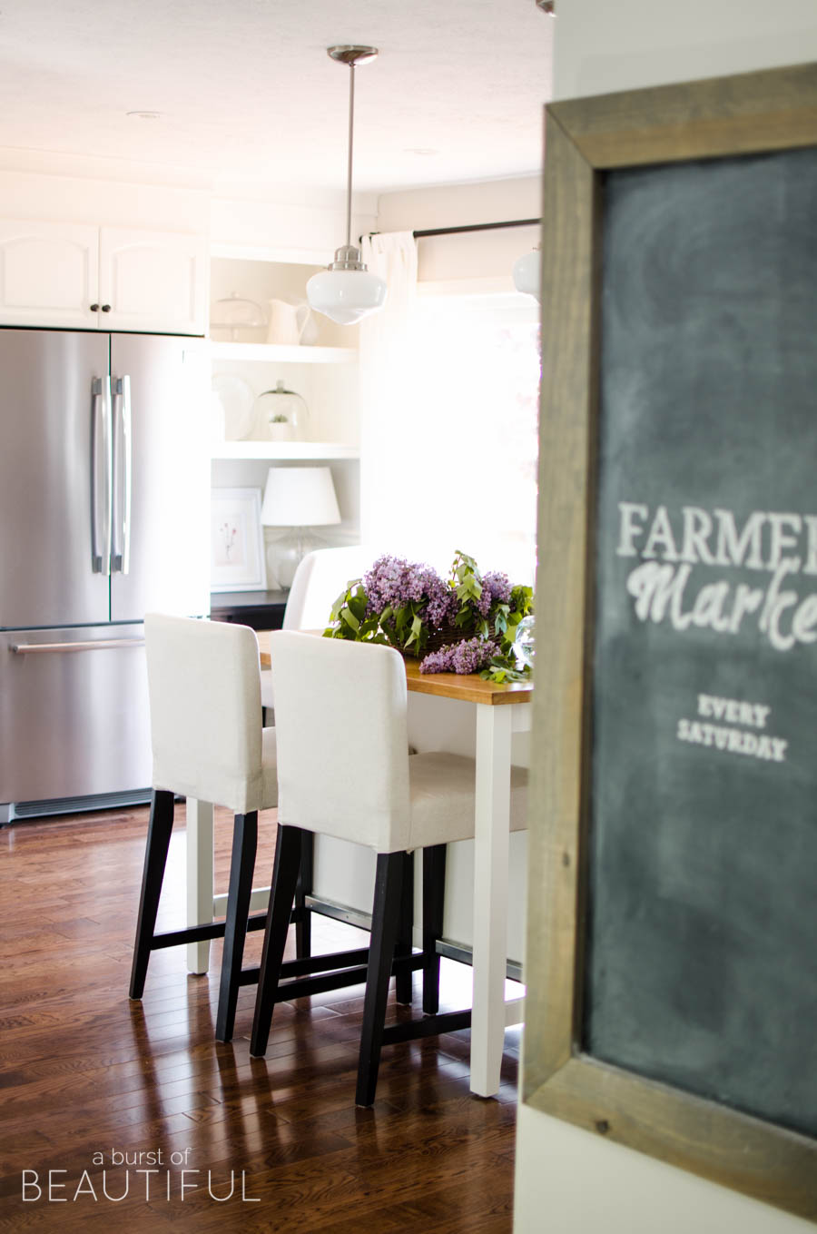 This beautiful modern farmhouse welcomes summer in