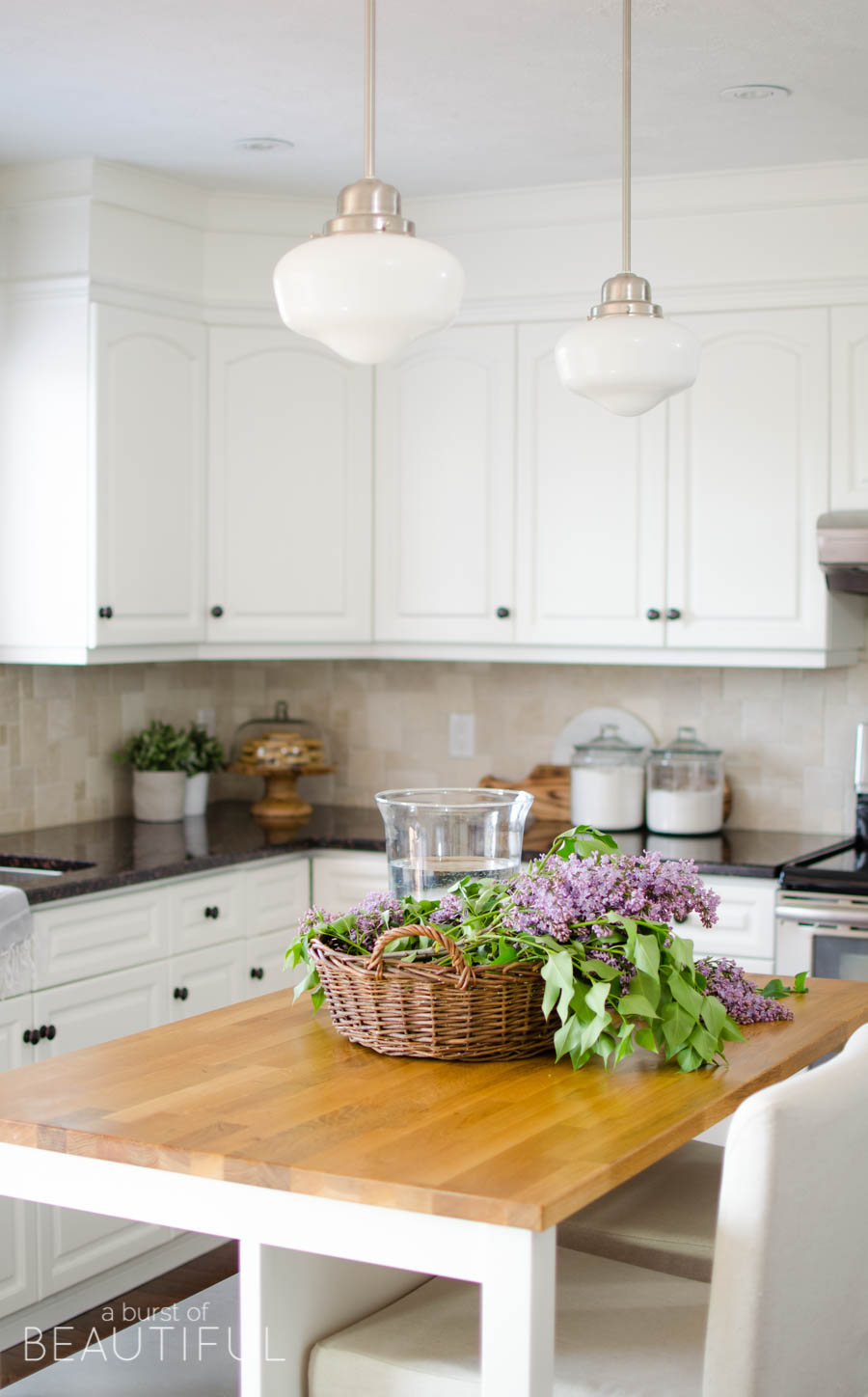 This beautiful modern farmhouse welcomes summer in the country with a fresh, light color palette of soft neutrals paired with plenty of natural wood tones, all highlighted with the simple pleasures of summertime - fresh flowers. The newly renovated mudroom, classic white kitchen and bright and airy open concept living and dining room make this the perfect family home. See all of the inspiring photos, plus 33 blogger home tours in this incredible Summer Home Tour series at www.aburstofbeautiful.com.