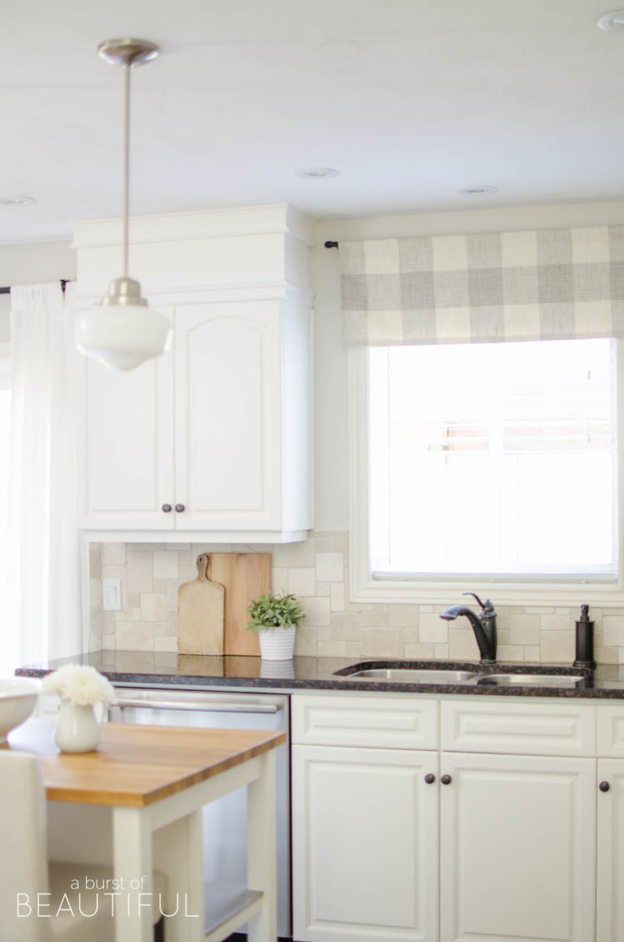 A window valance made from neutral buffalo check fabric compliments this simple farmhouse kitchen perfectly. Visit aburstofbeautiful.com for the full tutorial | A Burst of Beautiful