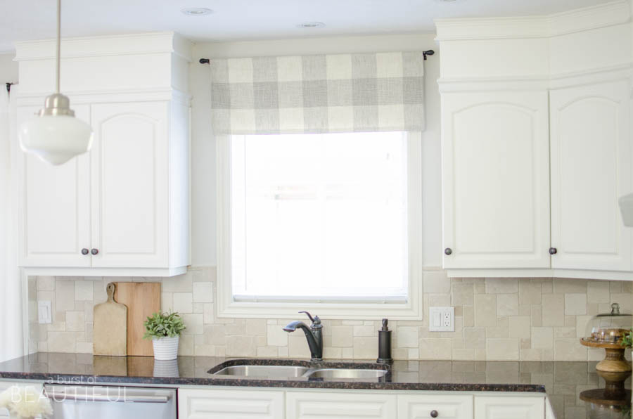 A Window Valance Made From Neutral Buffalo Check Fabric Compliments This  Simple Farmhouse Kitchen Perfectly.