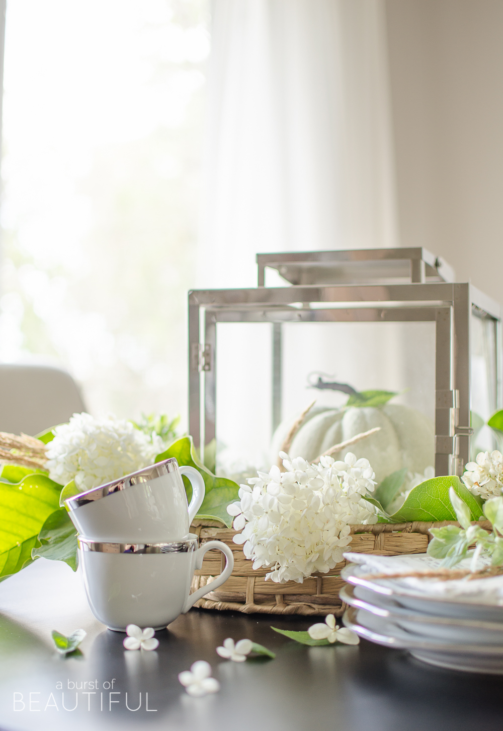 Hydrangeas, magnolia leaves and grasses create a simple and easy fall centerpiece.