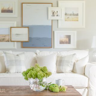 A white slipcovered sofa creates a casual and relaxed feel in this modern farmhouse