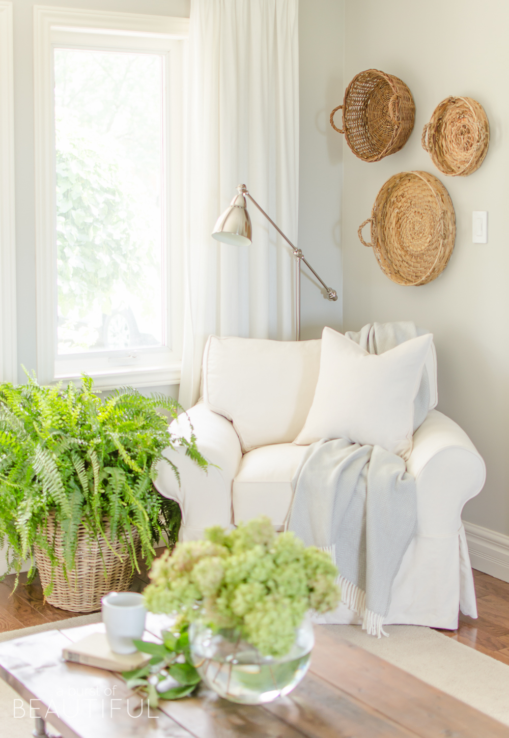 A White Slipcovered Sofa Looks Casual And Relaxed In This Charming  Farmhouse Living Room. Learn