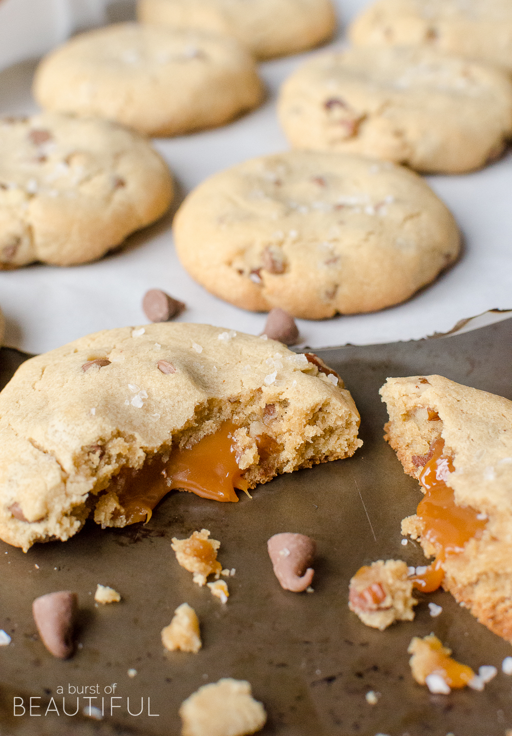 These caramel chocolate chip cookies are filled with a rich caramel center and melt-in-your-mouth chocolate chips.