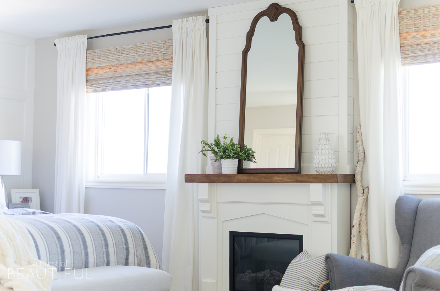 Woven wood shades add texture, color and warmth to this modern farmhouse
