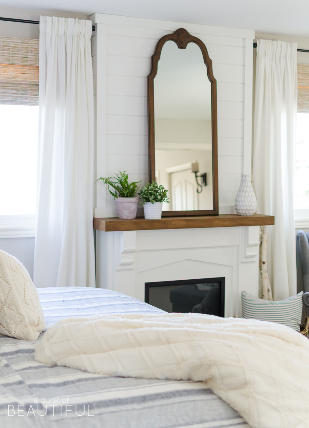 Cozy farmhouse master bedroom a burst of beautiful for Bedroom ideas with fireplace