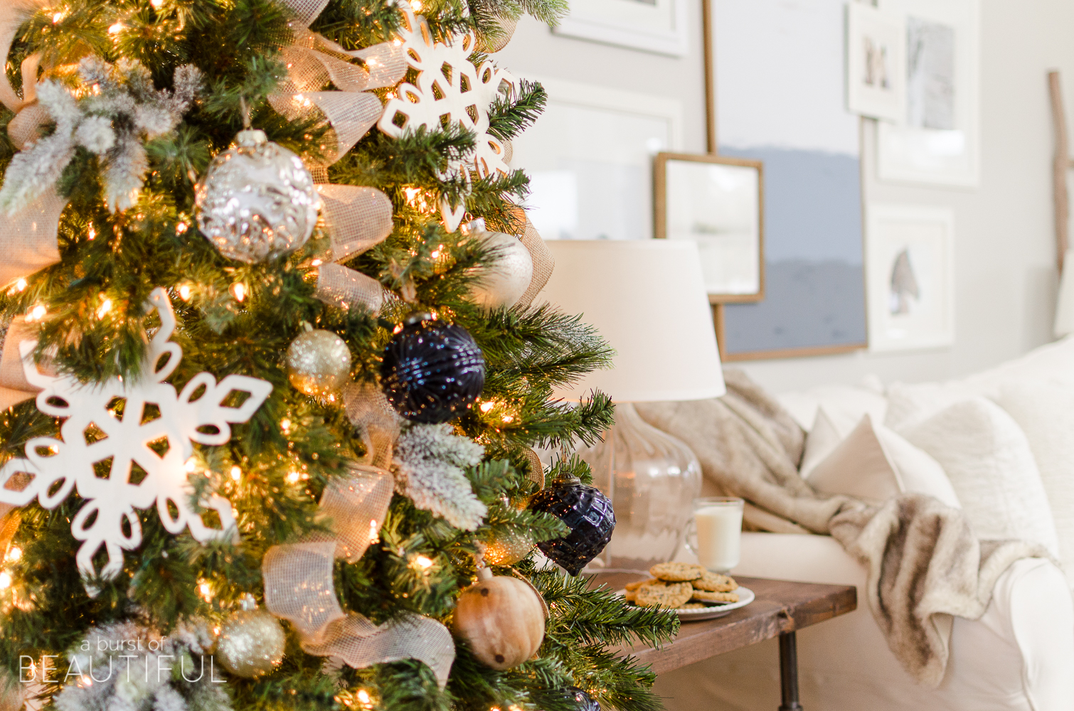 A navy and gold Christmas tree adds a touch of understated luxury to this modern farmhouse.