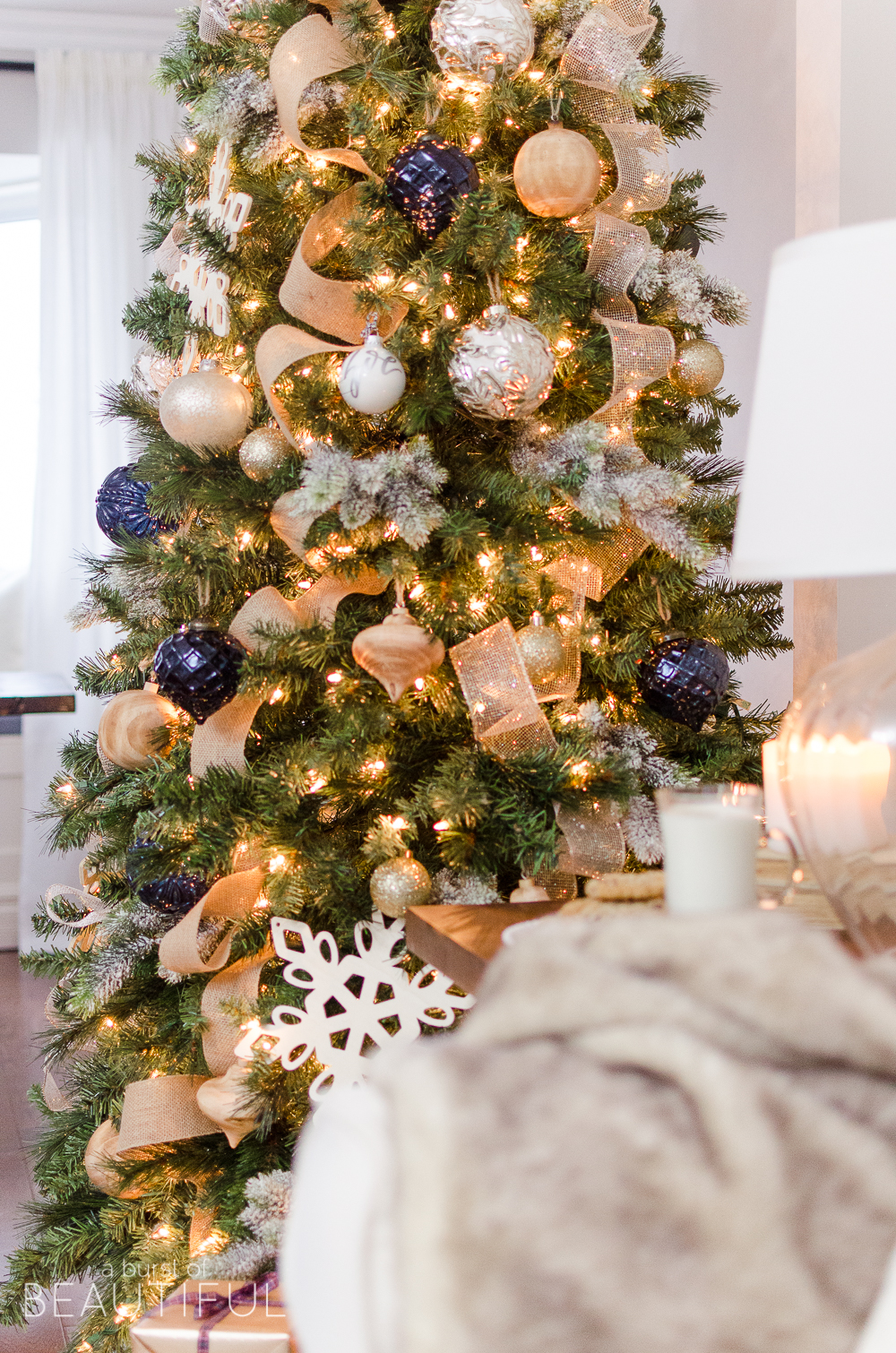 a navy and gold christmas tree adds a touch of understated luxury to this modern farmhouse - Gold Christmas Tree