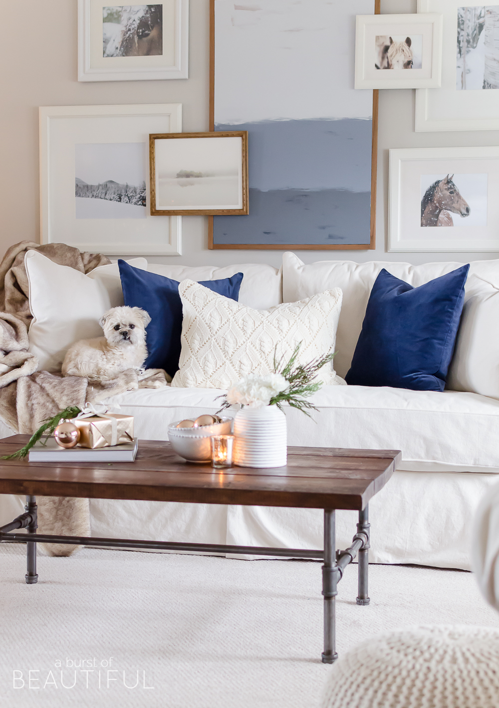 Natural wood tones, copper accessories and faux fur and velvet textiles create a cozy Christmas living room