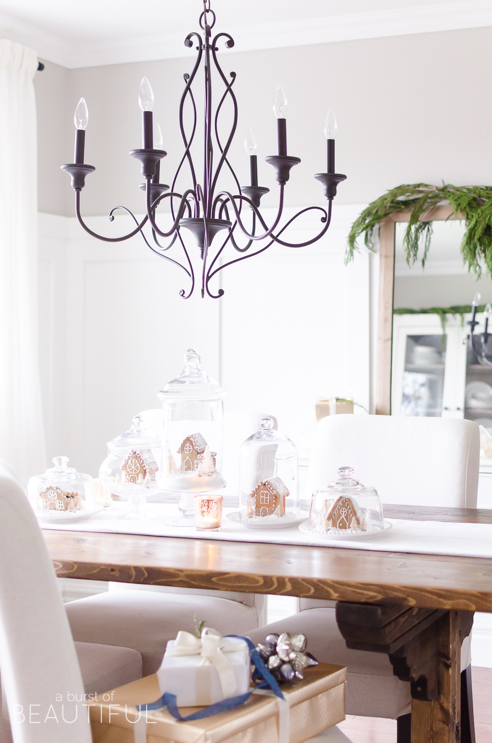 An inviting holiday dining room in this modern farmhouse is full of whimsical Christmas charm