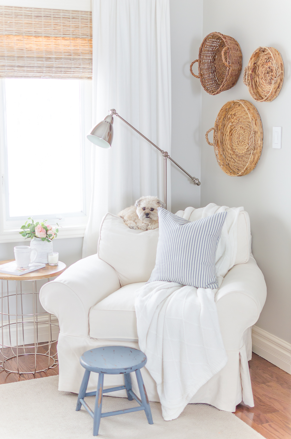 A distressed foot stool adds character to this cozy modern farmhouse. Find the project in A Touch of Farmhouse Charm by Liz Fourez.