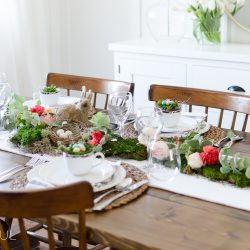 Add charm to your dining room with a floral and moss Easter tablescape.
