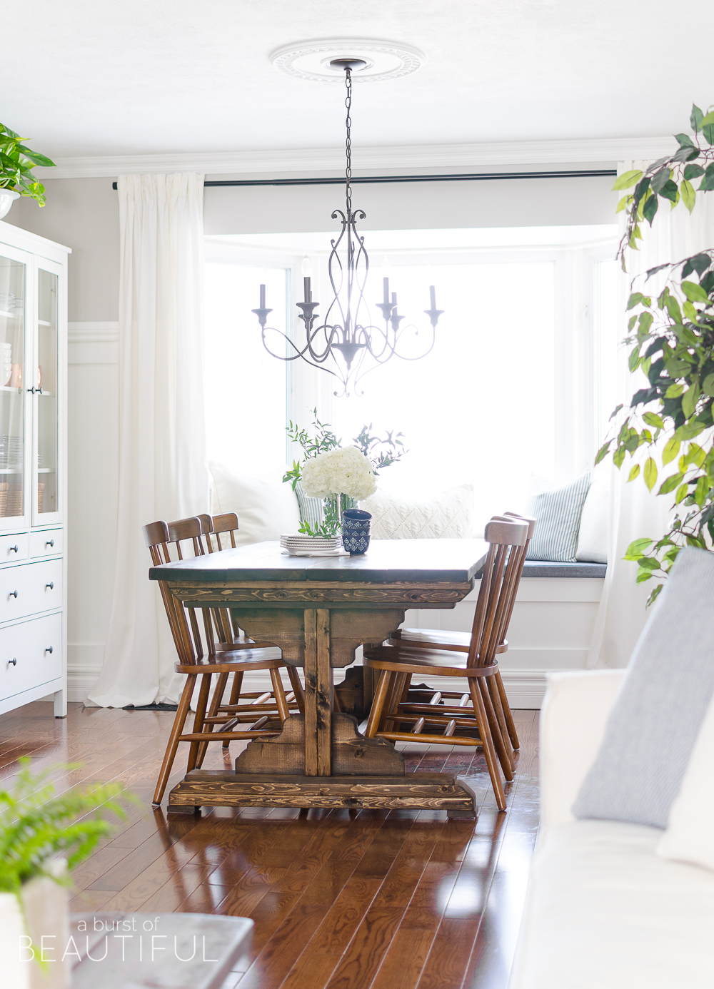 Spring Home Tour | Our Dining Room - A modern farmhouse feels bright and inviting as it embraces the spring season. Tour the full home at www.aburstofbeautiful.com.