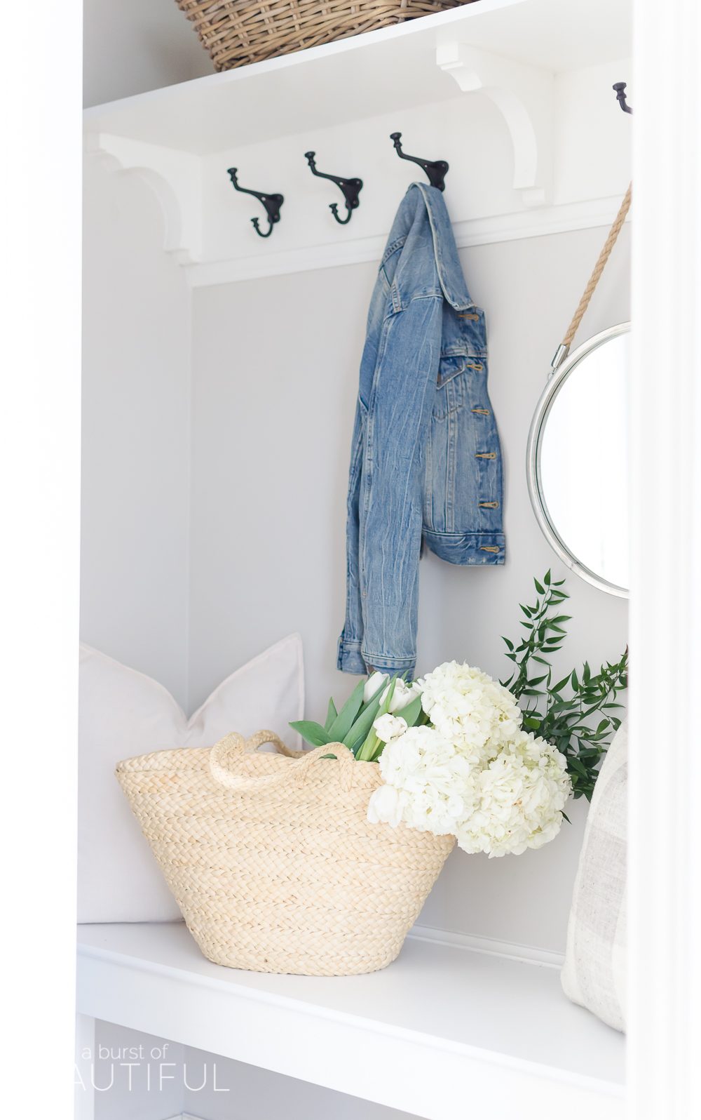 A pretty and functional mudroom is ready for the season in this modern farmhouse's bright and inviting spring home tour.