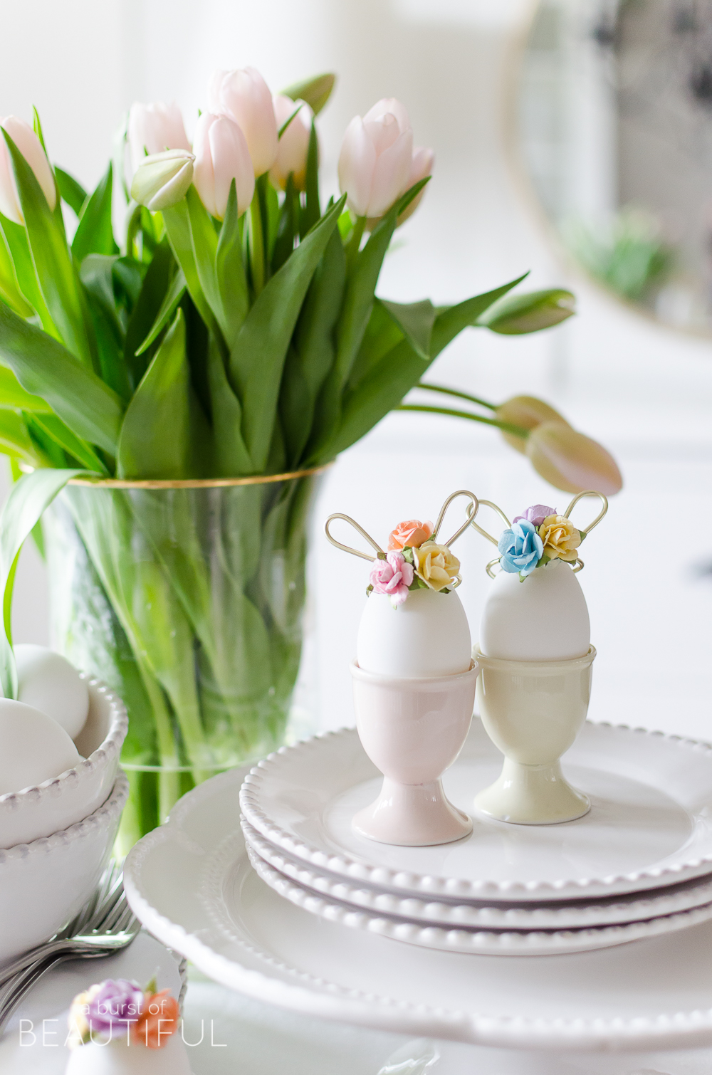 Easter Egg Decorating Idea | Decorate your Easter eggs this holiday with these miniature DIY gold wire bunny ears and floral crowns for a sweet and whimsical touch.