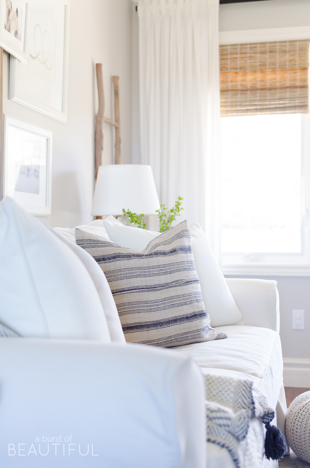 The easiest way to update your space is by adding new art and accessories, like throw pillows.