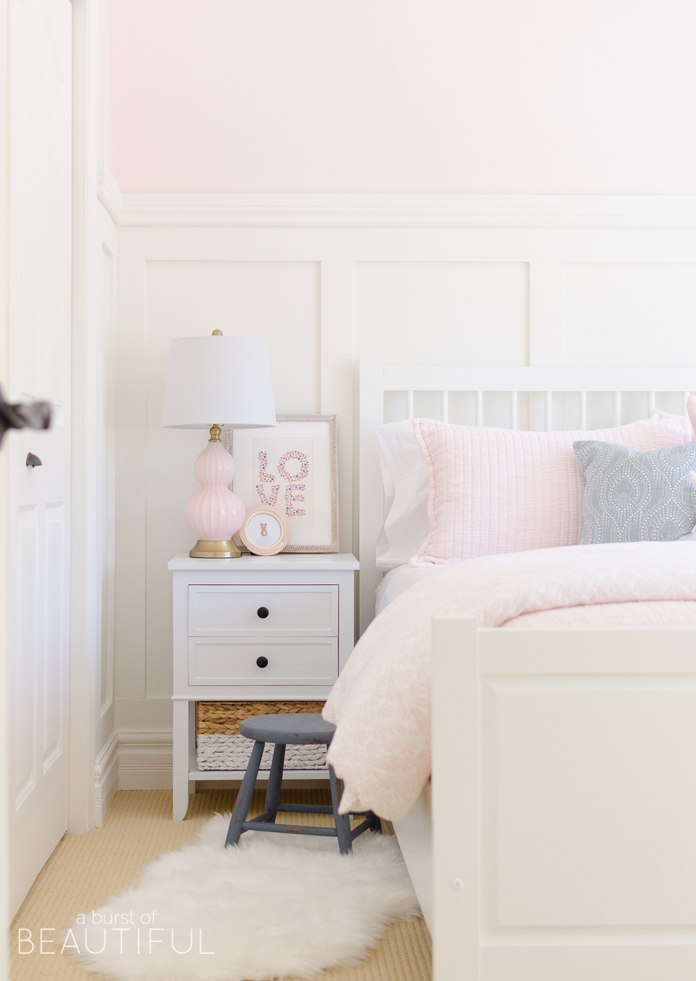 Toddler Girl Pink Bedroom Design & Decor sidetable with art and pink lamp