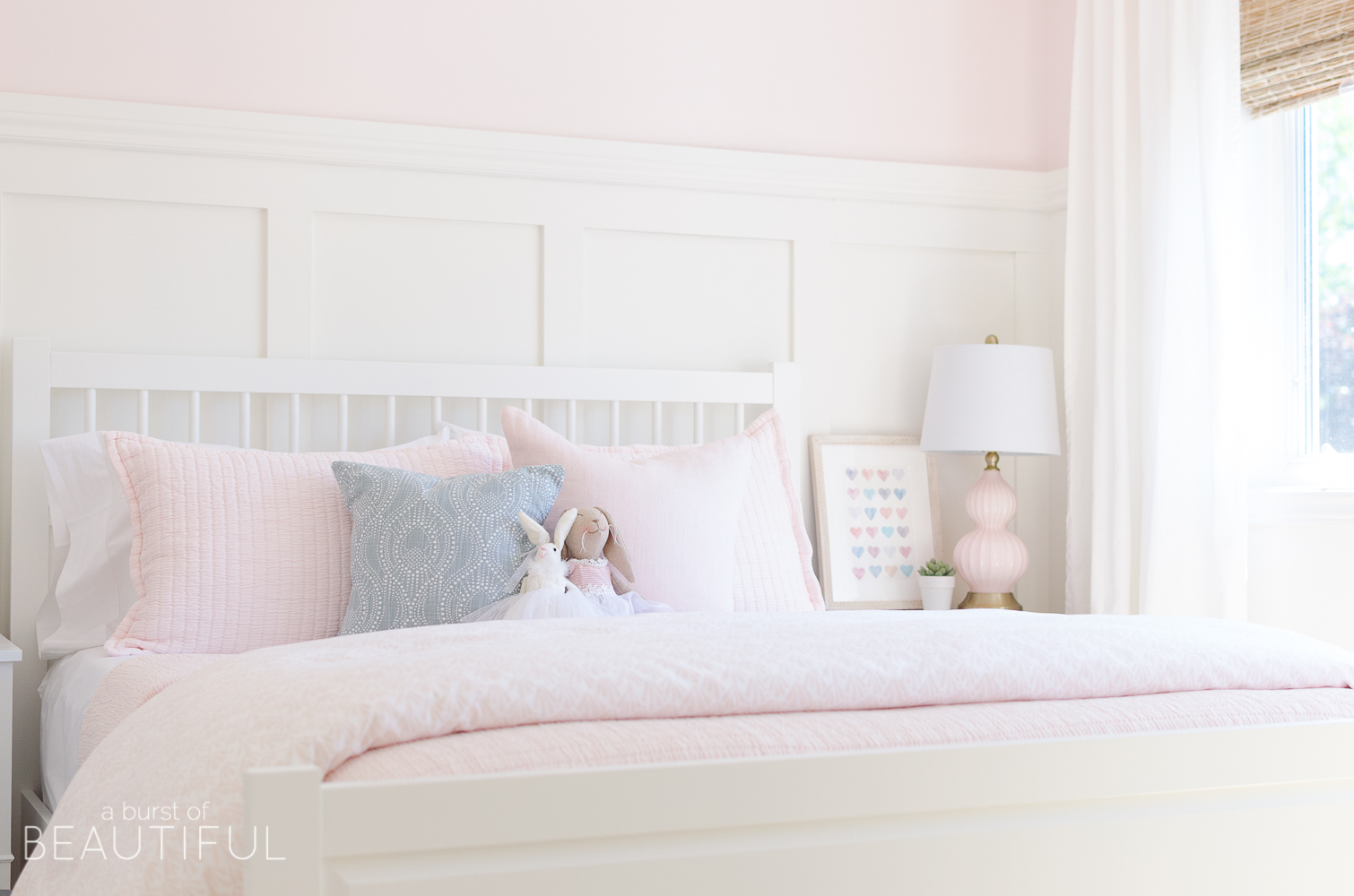 Toddler Girl Pink Bedroom Design & Decor Ideas with artwork, pillows, board and batten, pink comforter