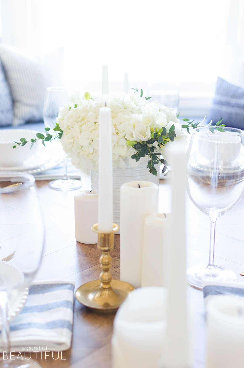 A simple spring tablescape set in a classic blue and white color palette with a centerpiece of white hydrangeas and crocuses leads to easy spring entertaining.