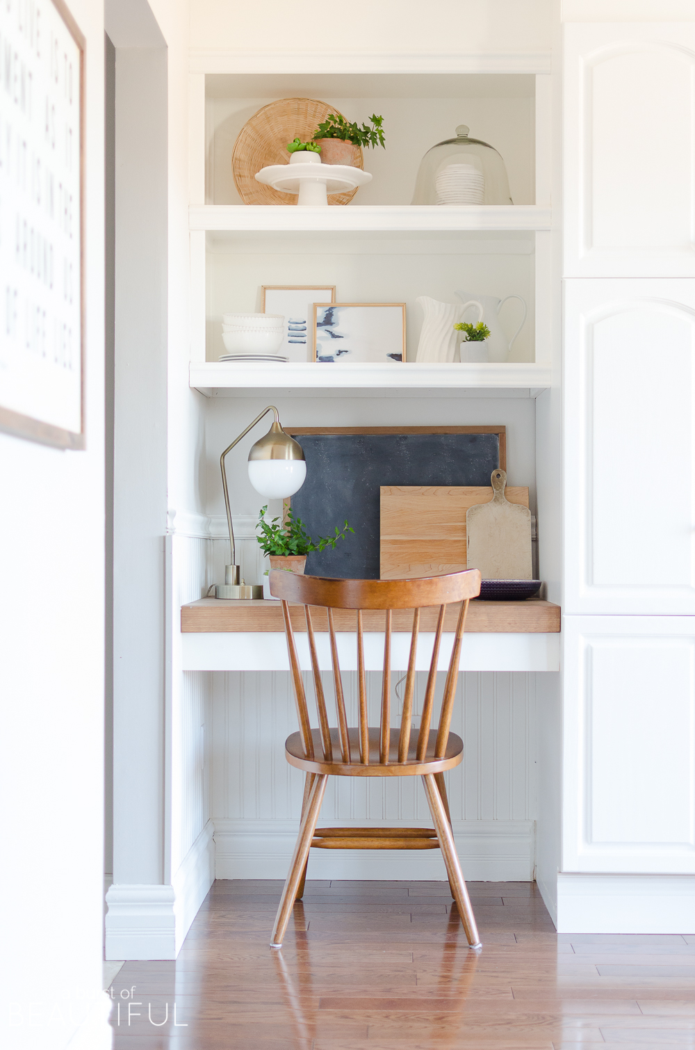 A small kitchen nook is decorated for spring with these simple and easy-to-follow steps for styling open shelving.