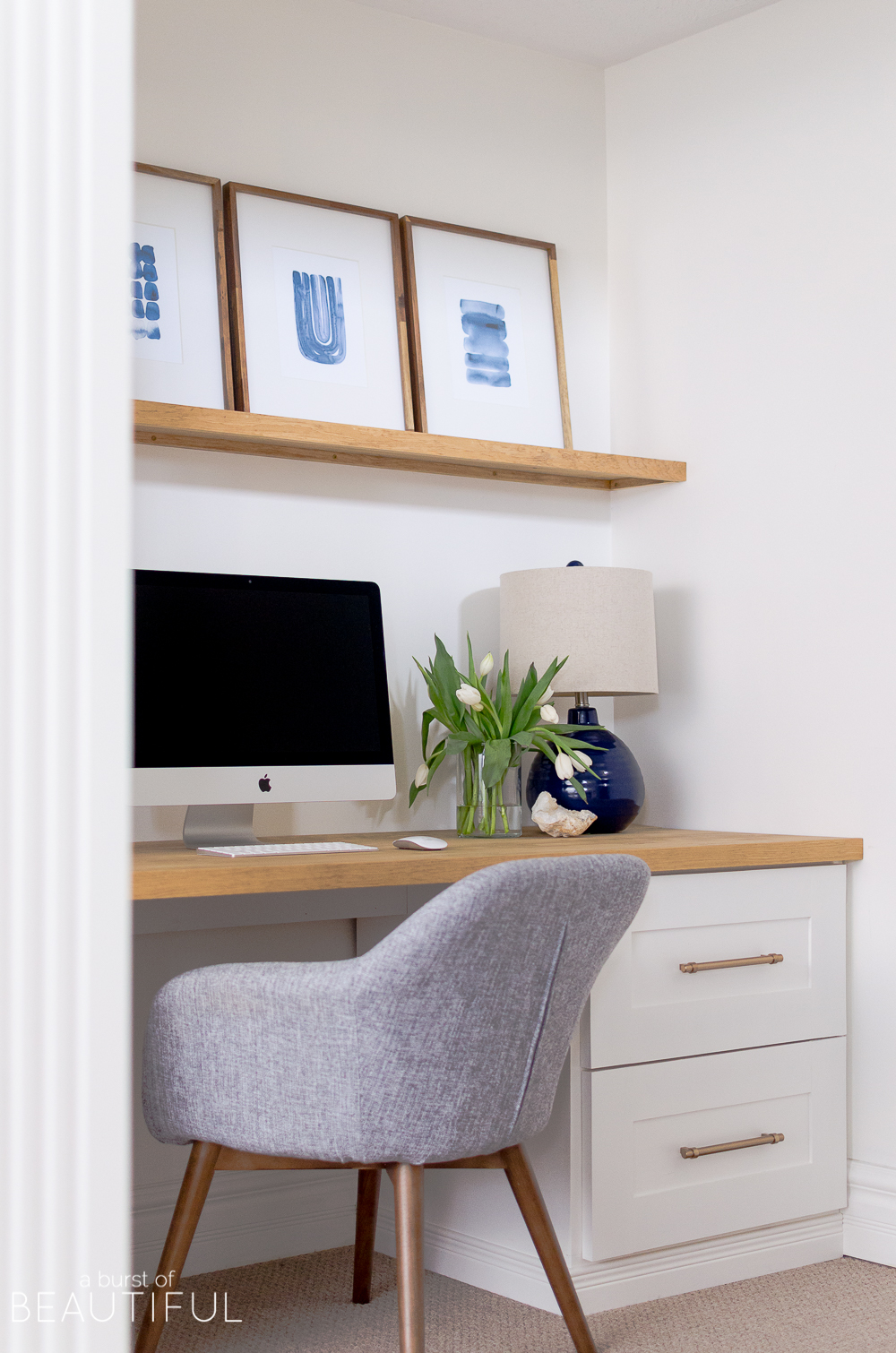 A small nook provides the perfect space for home office or studio, with this simple built-in desk