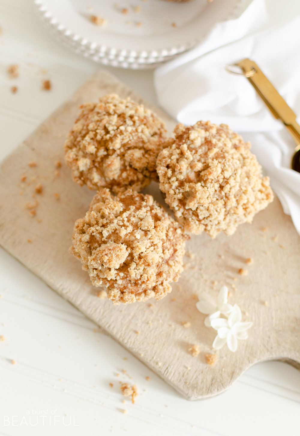 Make the most of the fall harvest with these easy homemade apple crumble muffins baked with fresh apples and topped with a brown sugar crumble.