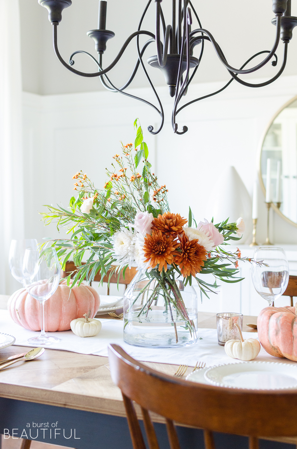 Find inspiration for entertaining this fall season with 16 festive fall tablescapes, including a simple fall table setting in traditional autumn colors.