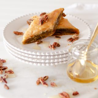 Our Pumpkin Pie Baklava is a modern variation to traditional Greek baklava recipes. Decadent pumpkin pie filling, pecans, and honey baked between layers of phyllo pastry create an irresistible fall dessert that will quickly become a seasonal favorite.