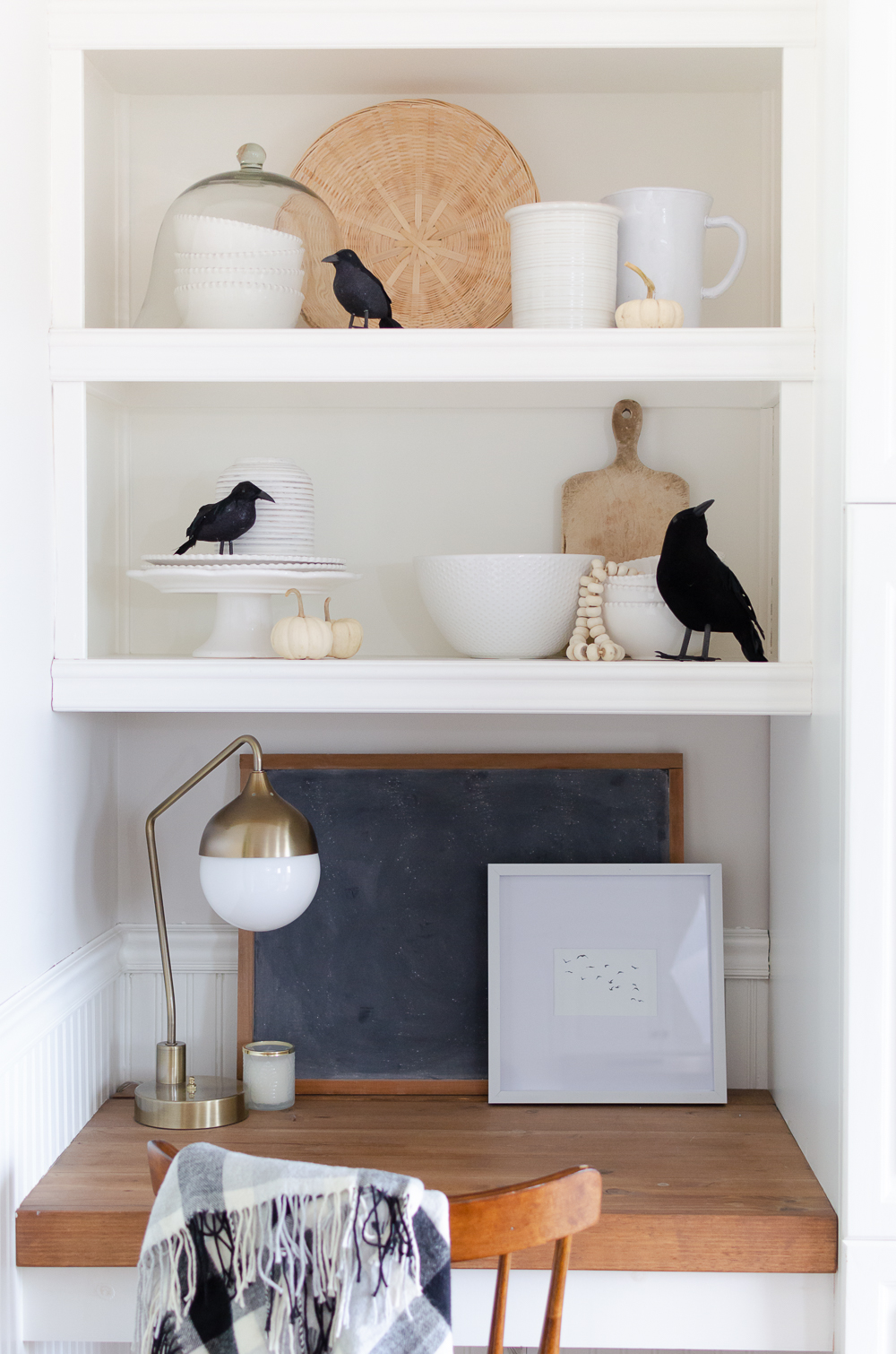 Mini white pumpkins and black crows are a simple way to add a touch of Halloween to your home.Get inspired and celebrate Halloween with 25+ easy decorating ideas.