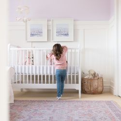 Soft shades of lavender and rose mixed with whimsical details bring this sweet and colorful nursery to life.