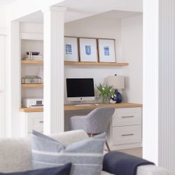 A simple renovation turns a basement into a modern and sophisticated family room, playroom and home office.