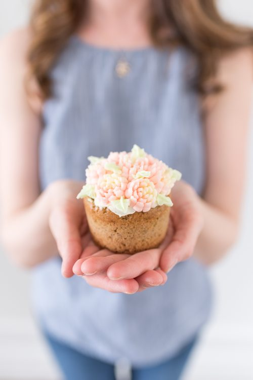 Banana Lavender Cupcakes Decorated With Buttercream Frosting Flowers
