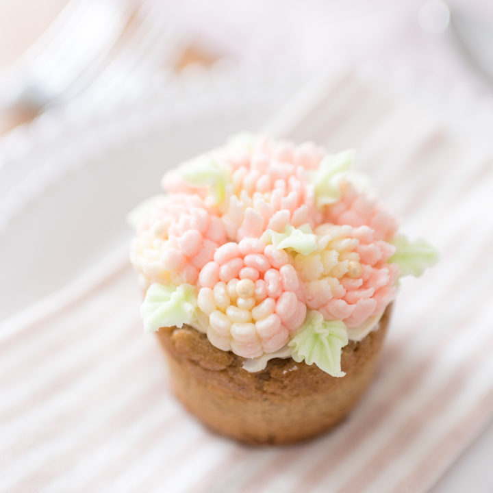 Banana lavender cupcakes decorated with simple buttercream frosting flowers are a sweet and pretty dessert for any occasion.