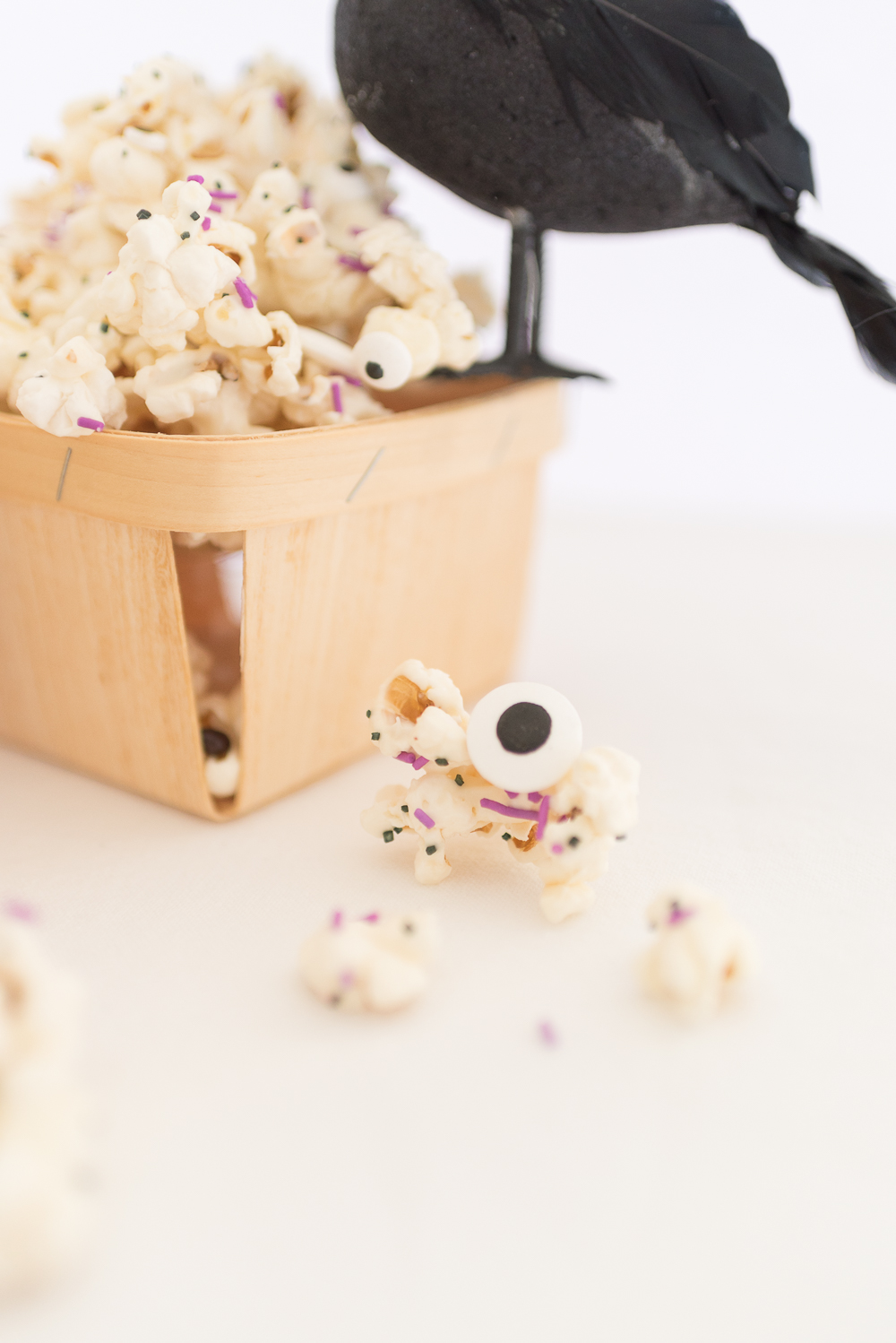 Halloween Monster popcorn drizzled in melted white chocolate and mixed with sprinkles and candy eyeballs