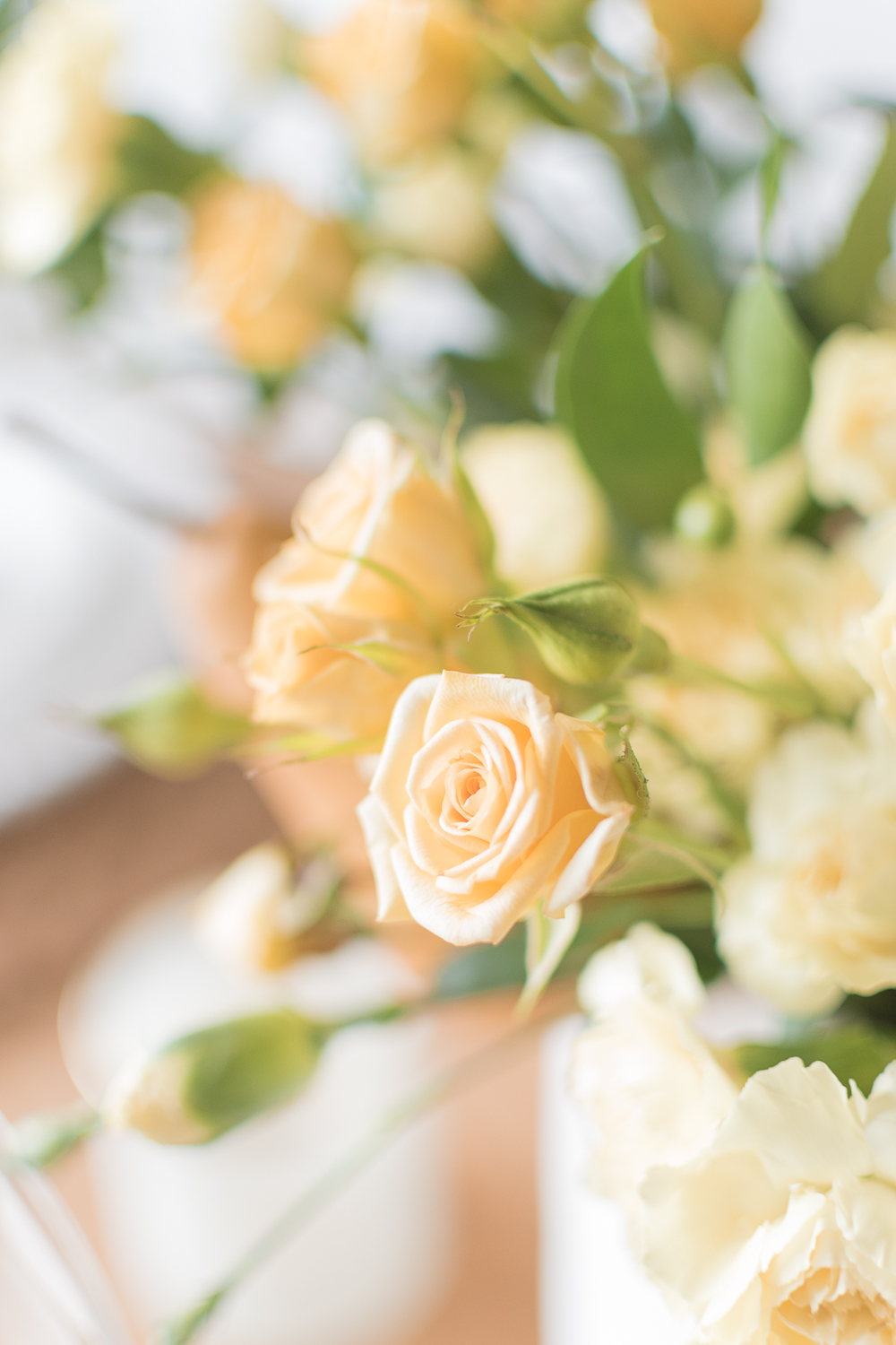 closeup rose fall and thanksgiving dining table decor