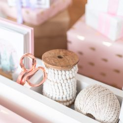 Build your own wrapping paper storage with two dowels to keep wrapping paper easily accessible and four cubbies to store all of your essentials, like Christmas cards, ribbon, scissors, and gift tags.