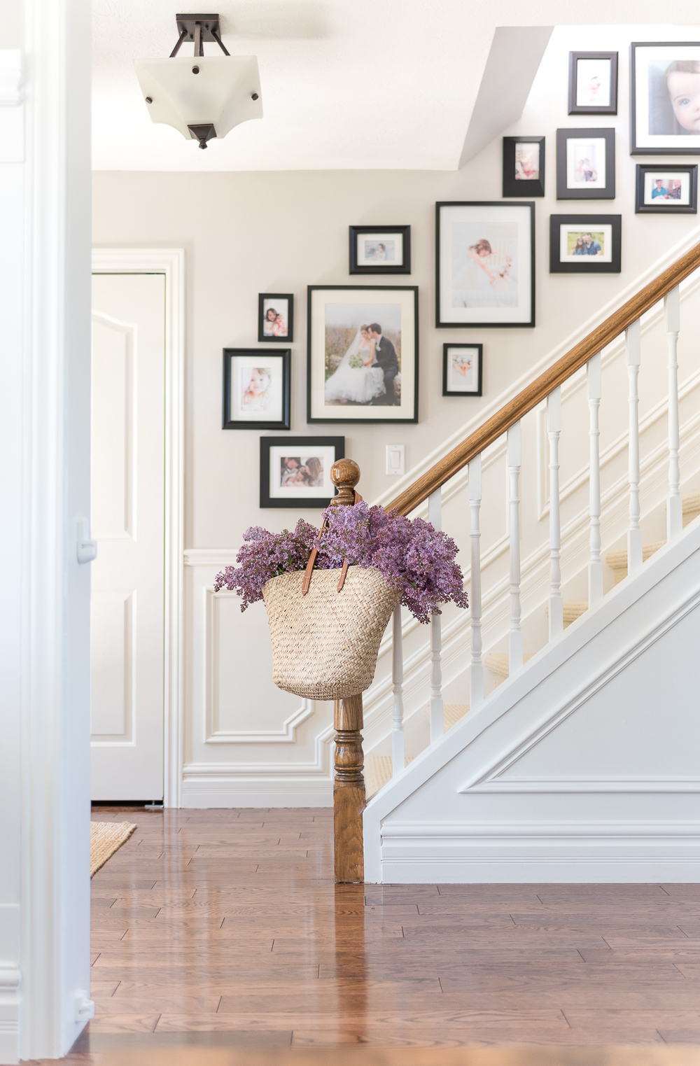 Staircase gallery wall with modern black frames